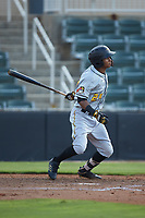 Lolo Sanchez (24) of the West Virginia Power follows through on his swing against the Kannapolis Intimidators at Kannapolis Intimidators Stadium on July 25, 2018 in Kannapolis, North Carolina. The Intimidators defeated the Power 6-2 in 8 innings in game one of a double-header. (Brian Westerholt/Four Seam Images)