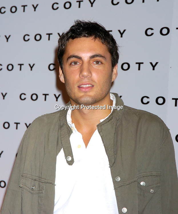 Fabian Basabe ..at Coty's 100th Anniversary Celebration  on September 12, 2004 at the  American Museum of Natural Historys Rose Center for Earth and Space ..Photo by Robin Platzer, Twin Images