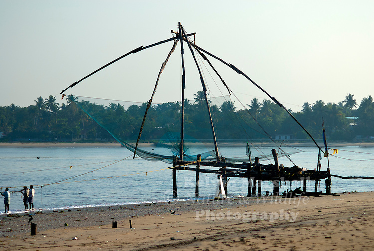 The Chinese fishing nets at Fort Kochi, located in the Kochi city of Kerala, make up a very popular tourist attraction. They are fixed land installations, which are used for a very unique and unusual method of fishing. Operated from the shore, these nets are set up on bamboo and teak poles and held horizontally by huge mechanisms, which lower them into the sea. They look somewhat like hammocks and are counter-weighed by large stones tied to ropes.