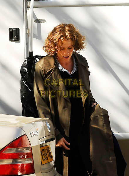 "FRANCES McDORMAND.Filming ""Miss Pettigrew Lives for a Day"" in Lincoln Inn Fields, London, England. She is also the executive producer of the movie..April 19th, 2007.on the set of half length brown coat jacket .CAP/IA.©Ian Allis/Capital Pictures"