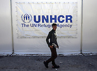 Pictured: A man walks by an UNHCR tent Friday 26 February 2016<br /> Re: Hundreds of refugees have been given temporary shelter at the Stefanakis Army Camp in the Schisto area of Athens, Greece.