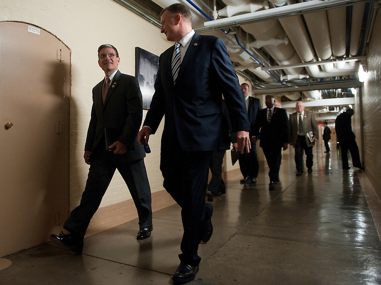 UNITED STATES - AUGUST 1: From left, Rep. Joe Heck, R-Nev., and Rep. Tom Rooney, R-Fla., arrive for the House Republicans' caucus meeting on the debt ceiling increase on Monday, Aug. 1, 2011, in the basement of the Capitol . (Photo By Bill Clark/Roll Call)