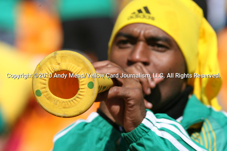 11 JUN 2010: South Africa fan with a vuvuzela in the stands of the Soccer City Stadium blowing a vuvuzela, pregame. The South Africa National Team played the Mexico National Team at Soccer City Stadium in Johannesburg, South Africa in the opening match of the 2010 FIFA World Cup.