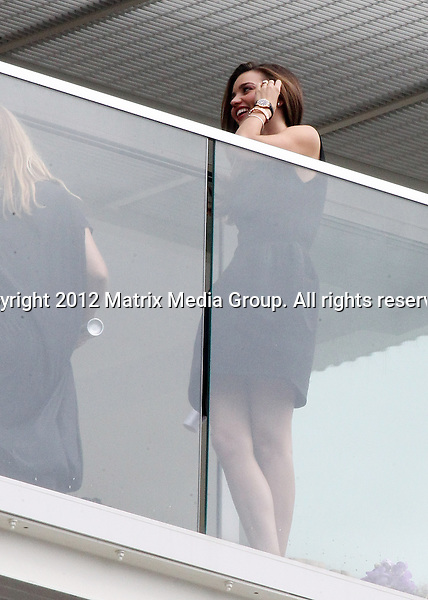 13 FEBRUARY 2013 SYDNEY AUSTRALIA ..NON EXCLUSIVE ..Miranda Kerr Pictured on the balcony of the Swiss Grande Hotel posing for media after appearing on Sunrise morning show...*No internet without clearance*.MUST CALL PRIOR TO USE ..+61 2 9211-1088.Matrix Media Group.Note: All editorial images subject to the following: For editorial use only. Additional clearance required for commercial, wireless, internet or promotional use.Images may not be altered or modified. Matrix Media Group makes no representations or warranties regarding names, trademarks or logos appearing in the images.