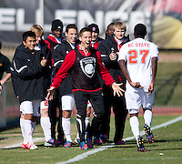 Philip Carmon (27) of North Carolina State celebrates his teammates after scoring during the game at Ludwig Field in College Park, MD. Virginia Tech defeated North Carolina State, 3-2, in the ACC tournament play-in game.