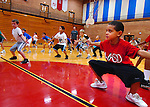 Keystone Basketball Camp at the YMCA, Pickelner Arena on Jan. 3, 2009.Players practice their defensive stance  during Little Millionaires basketball practice at the high school Tuesday Oct. 26, 2010.