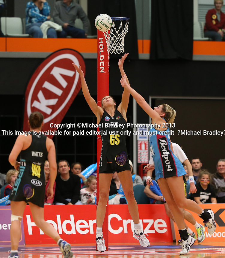 02.06.2013 Magic's Irene Van Dyk and Steel's Storm Pervis in action during the ANZ Champs netball match between the Magic and Steel played at Rotorua Events Centre in Rotorua. Mandatory Photo Credit ©Michael Bradley.