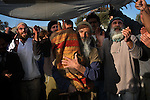 Avri Ran carries a new Torah scroll into the synagogue of the unauthorized Israeli outpost of Givot Olam, West Bank.<br />