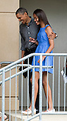United States President Barack Obama walks with his daughter Malia from the Strathmore Music Center in Bethesda, Maryland, on Sunday, June 16, 2013. The Obama's were attending a dance performance with where their daughter Sasha was performing. <br /> Credit: Joshua Roberts / Pool via CNP