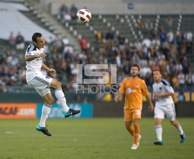 LA Galaxy midfielder Landon Donovan (10) with a headball over the middle. The Puerto Rico Islanders defeated the LA Galaxy 4-1 during CONCACAF Champions League group play at Home Depot Center stadium in Carson, California on Tuesday July 27, 2010.