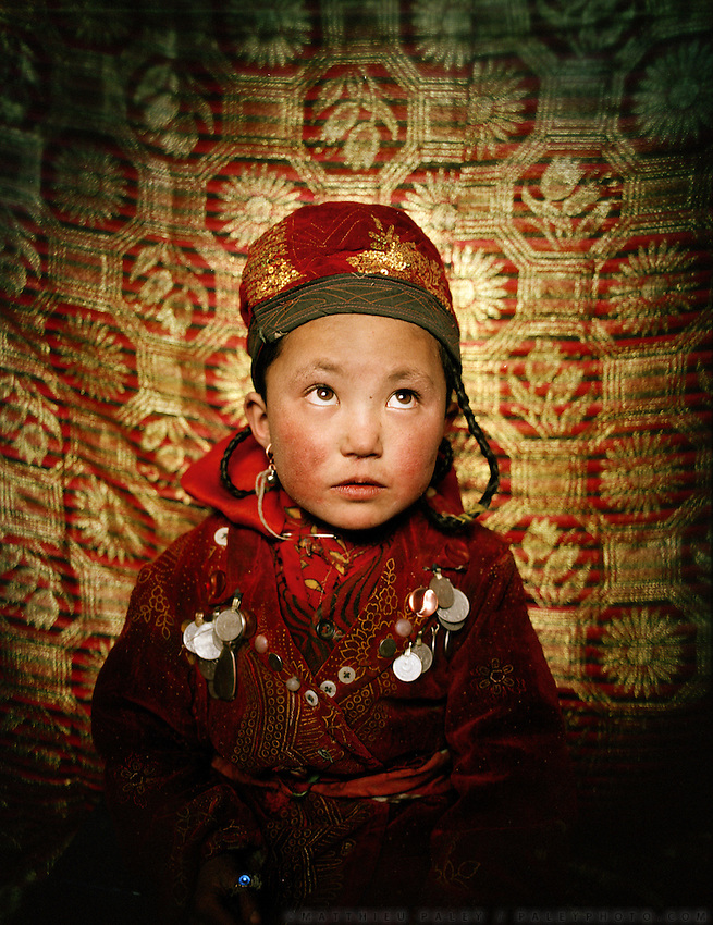 Portrait of Susaï (6 years old), Sultan's daughter..Campment of Tshar Tash (Haji Osman's camp), in the Wakhjir valley, at the source of the Oxus..Winter expedition through the Wakhan Corridor and into the Afghan Pamir mountains, to document the life of the Afghan Kyrgyz tribe. January/February 2008. Afghanistan
