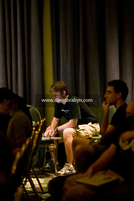 An attendee of the 6th edition of HOPE, an annual hackers' convention, spends time on his laptop, July 22nd 2006, New York City, USA.