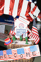 "A display reading ""Deplorables for Trump"" with signs saying ""homophobe,"" ""xenophobe,"" and ""Support our Troops"" stands on a table in the Palm Beach Republican Club and West Palm Beach Victory Headquarters office in West Palm Beach, Florida. The office serves as a place for volunteers to gather and organize for various Republican campaigns, including Donald Trump's general election campaign. The ""deplorables"" sign is a reference to a Hillary Clinton campaign speech in which she called half of Donald Trump's supporters a ""basket of deplorables."""