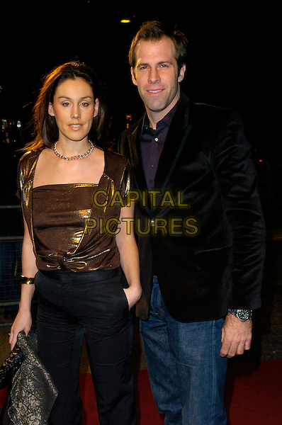 "LUCY RUSEDSKI & GREG RUSEDSKI.Arrivals - ""An Audience With Lionel Richie"" TV recording, ITV Television Centre, Aouth Bank, London, England, December 9th 2006..half length married husband wife gold metallic top couple.CAP/CAN.©Can Nguyen/Capital Pictures"