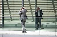 Mitglieder der CSU, telefonieren waehrend der Sitzung der CSU-Fraktion im Deutschen Bundestag.<br /> Nachdem es zwischen der CDU und der CSU zum Streit ueber den Umgang mit Fluechtlingen gab. Die Sitzung des Deutschen Bundestag wurde aufgrund dieses Streit auf Antrag der CDU/CSU-Fraktion fuer mehrere Stunden unterbrochen. Die Fraktionen von CDU und CSU tagten getrennt.<br /> 14.6.2018, Berlin<br /> Copyright: Christian-Ditsch.de<br /> [Inhaltsveraendernde Manipulation des Fotos nur nach ausdruecklicher Genehmigung des Fotografen. Vereinbarungen ueber Abtretung von Persoenlichkeitsrechten/Model Release der abgebildeten Person/Personen liegen nicht vor. NO MODEL RELEASE! Nur fuer Redaktionelle Zwecke. Don't publish without copyright Christian-Ditsch.de, Veroeffentlichung nur mit Fotografennennung, sowie gegen Honorar, MwSt. und Beleg. Konto: I N G - D i B a, IBAN DE58500105175400192269, BIC INGDDEFFXXX, Kontakt: post@christian-ditsch.de<br /> Bei der Bearbeitung der Dateiinformationen darf die Urheberkennzeichnung in den EXIF- und  IPTC-Daten nicht entfernt werden, diese sind in digitalen Medien nach &szlig;95c UrhG rechtlich geschuetzt. Der Urhebervermerk wird gemaess &szlig;13 UrhG verlangt.]