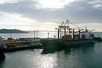 A small freighter loads a cargo of bananas and coffee in the Port of Limon, Costa Rica on the Caribbean side of the country...Freighter, shipping, docks.