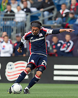 New England Revolution midfielder Lee Nguyen (24) shoots the ball. In a Major League Soccer (MLS) match, the New England Revolution defeated Portland Timbers, 1-0, at Gillette Stadium on March 24, 2012