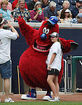 Aces mascot Archie poses with the girl who threw out the first pitch on Friday night.  Tom Smedes photo.