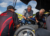 Jun 16, 2017; Bristol, TN, USA; Jim Head (center) team owner and crew chief for the car of NHRA funny car driver Jonnie Lindberg during qualifying for the Thunder Valley Nationals at Bristol Dragway. Mandatory Credit: Mark J. Rebilas-USA TODAY Sports