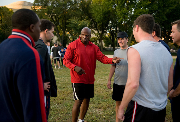 Retired NFL player Ken Harvey instructs congressmen during a flag football practice on the Mall, Oct. 8, 2009, in preparation for the upcoming game in which congressmen square off against the Capitol Police.