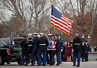 The flag-draped casket of former President George H.W. Bush is carried by a joint services military honor guard from the U.S. Capitol and loaded into a hearse, Wednesday, Dec. 5, 2018, in Washington. <br /> Credit: Shawn Thew / Pool via CNP / MediaPunch
