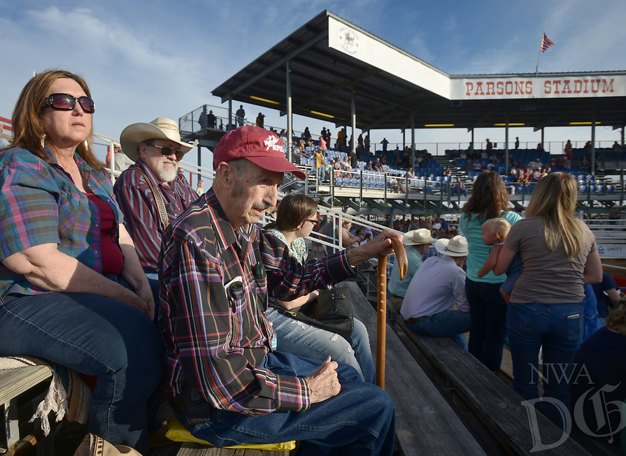 NWA Democrat-Gazette/BEN GOFF @NWABENGOFF<br /> Betty Fitch (from left) and husband Nevada Fitch join Nevada's father Frank Fitch, all of Hindsville, in the stands Friday, June 23, 2017, during the third night of the 73rd annual Rodeo of the Ozarks at Parsons Stadium in Springdale. Frank Fitch has attended the Rodeo of the Ozarks each of the 73 years it's been held.