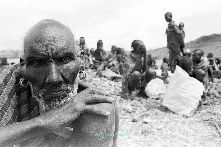 A Turkana man arrives for food during a famine relief operation on the edge of the Suguta Valley.<br /> Northern Kenya. <br /> These nomadic herders have left the valley for the first time in their lives so bad was the drought which hit their region.