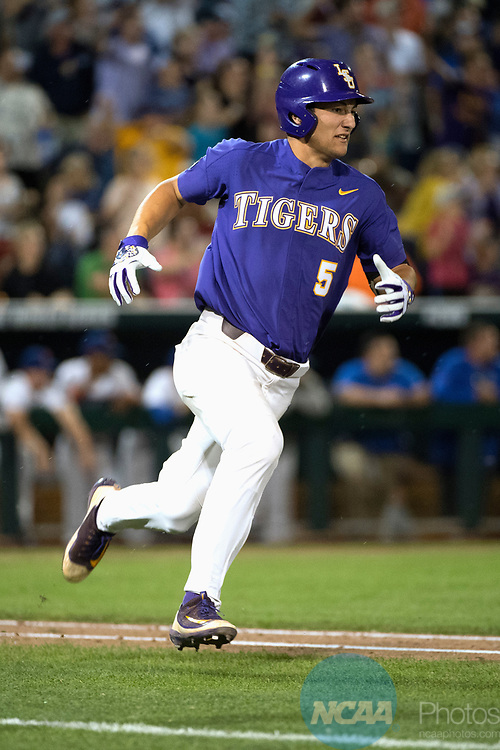 OMAHA, NE - JUNE 27: Jake Slaughter (5) of Louisiana State University hits a single against the University of Florida during the Division I Men's Baseball Championship held at TD Ameritrade Park on June 27, 2017 in Omaha, Nebraska. The University of Florida defeated Louisiana State University 6-1 in game two of the best of three series. (Photo by Jamie Schwaberow/NCAA Photos via Getty Images)
