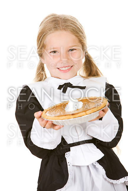 Little girl dressed as a Thanksgiving Pilgrim.