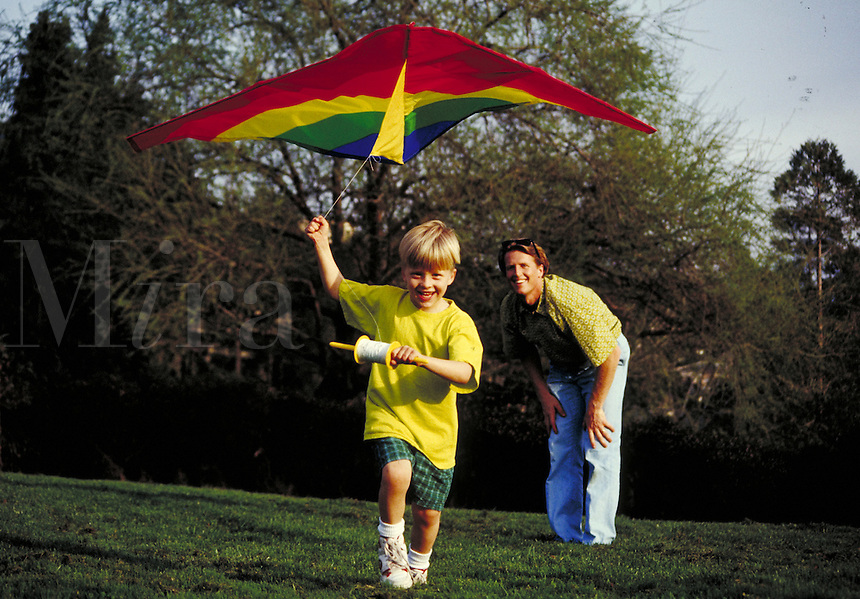 CAUCASIAN FATHER AND SON FLYING A KITE IN A PARK. FATHER AND SON. SAN FRANCISCO CALIFORNIA USA PARK.