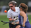 Daniella Specht #14 of Baldwin, left, gets pressured by Gianna Viaggio #17 of New Hyde Park during a Nassau County Conference I varsity field hockey match at Baldwin High School on Wednesday, Sept. 28, 2016. Specht broke a scoreless tie with an unassisted goal in the second half. Baldwin went on to win by a score of 2-0.