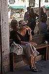 Venice Italy 2009. Woman drinking a orange drink Campari and Soda Campo Cesare Battisti.