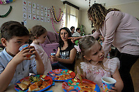 "Birthday party for Ece Yanc at Ayar Yanc family in Maslak neighborhood.  There are multiple families with four immigrant nannies/housecleaners at the party.  Gul is from this house and she is from Turkmenistan the other three are from Uzbekistan.  Many domestic workers come illegally or are smuggled in to make money to support their own children and families back home...Turkey is primarily affected by internal migration.  Istanbul was 2 million 30 years ago and is now 12 million.  People I photographed in Yayla (Agricultural) lifestyle 10 years ago are now all office workers in Istanbul.  There just isn't a good way to make a living in the rural areas anymore.  In 30 years Turkey has gone from being 70 percent rural to 70 percent urban.  The average in the world is 51 percent urban..Turkey is also a spinning top for migration to Europe from Iraq, Iran, Afghanistan and Sudan.  Sudanese go first to Libya and then on to Turkey.  Turkey is very late to the party to deal with immigration and one of the factors for EU membership is that they need to deal with this.  They are still working off a 1951 law that limits immigration to ONLY wealthy west Europe countries.  Meanwhile Africa receives more refugees than Europe.  250,000 foreigners seek a better life by moving THROUGH Turkey, but few want to stay.  But if you are Muslim you tend to stay longer.  According to the UNHCR lawyer here Muslims are not considered ""good"" refugees by many EU countries and the USA.  Even though Turkey does not officially welcome anyone outside the geographic restriction of wester Europe, they are more humane to them once they sneek into the country.  UNHCR helps them get hospital care and their children into schools... relief organizations treat them as the ""guest"" that has such a special place in the Islamic religion.  According the the UNHCR lawyer the criminilization of immigration is the worst part of this whole scene."