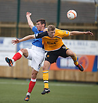 Lee McCulloch and Peter Watson do battle