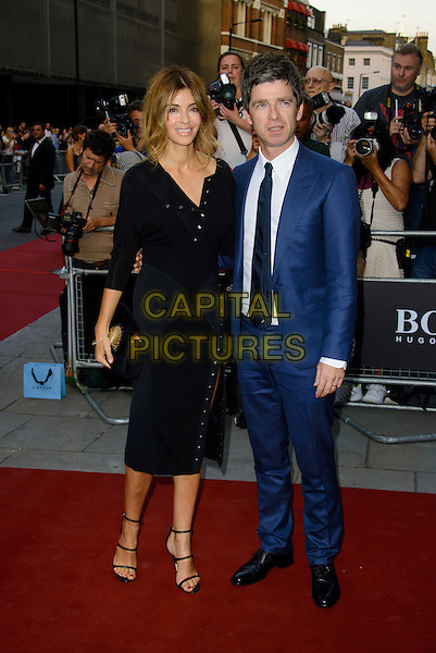 Sarah MacDonald &amp; Noel Gallagher<br /> GQ Men of the Year Awards 2013 at the Royal Opera House, London, England.<br /> September 3rd, 2013<br /> full length black dress blue suit married husband wife <br /> CAP/CJ<br /> &copy;Chris Joseph/Capital Pictures