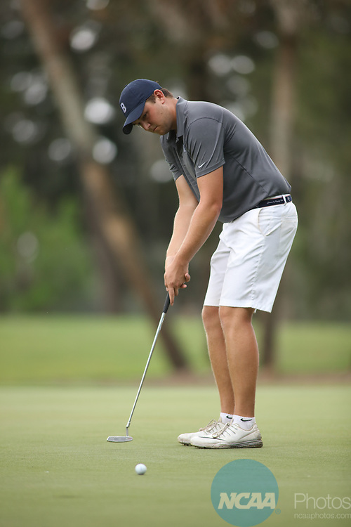 HOWEY IN THE HILLS, FL - MAY 19: Ryan Elmore of Berry College putts during the Division III Men's Golf Championship held at the Mission Inn Resort and Club on May 19, 2017 in Howey In The Hills, Florida. (Photo by Cy Cyr/NCAA Photos via Getty Images)