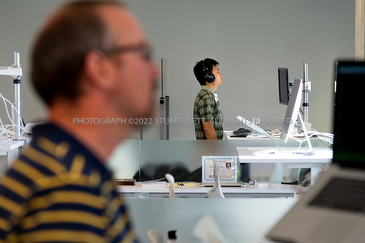 SEATTLE, USA - SEPTEMBER 16th, 2015<br /> <br /> Xuchen Yao (back), a university collaborator from Johns Hopkins University, at work at his desk at the Allen Institute for Artificial Intelligence in Seattle, WA, USA.<br /> <br /> The Allen Institute for Artificial Intelligence (abbreviated AI2) is a research institute funded by Microsoft co-founder Paul Allen to achieve scientific breakthroughs by constructing AI systems with reasoning, learning and reading capabilities. Oren Etzioni was appointed by Paul Allen in September 2013 to direct the research at the institute.<br /> <br /> (Photo by Stuart Isett for The Washington Post)