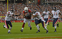 Oct. 16, 2006; Glendale, AZ, USA; Arizona Cardinals  wide receiver Bryant Johnson (80) runs between Chicago Bears cornerback (33) Charles Tillman and safety (38) Danieal Manning to score a touchdown at University of Phoenix Stadium in Glendale, AZ. Mandatory Credit: Mark J. Rebilas