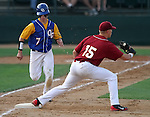 SIOUX FALLS, SD - MAY 26:  Ben Reznicek #7 from O'Gorman is thrown out at first as Scott Tyler #15 from Roosevelt catches the ball in the first inning during the Class A Championship Game Saturday night at the Sioux Falls Stadium. (Photo by Dave Eggen/Inertia)