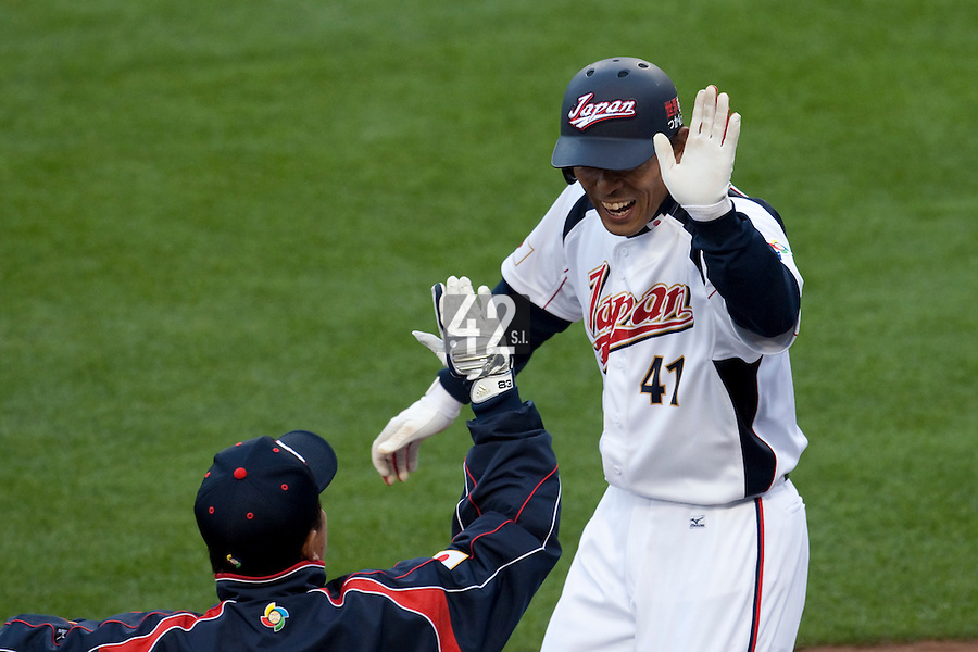 22 March 2009: #41 Atsunori Inaba of Japan celebrates with teammate after scoring on a sacrifice fly by Johjima, Kenji #2 in the fourth inning during the 2009 World Baseball Classic semifinal game at Dodger Stadium in Los Angeles, California, USA. Japan wins 9-4 over Team USA.