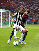 Calcio, finale di Champions League Juventus vs Barcellona all'Olympiastadion di Berlino, 6 giugno 2015.<br /> Juventus' Arturo Vidal, left, is challenged by FC Barcelona's Gerard Pique' during the Champions League football final between Juventus Turin and FC Barcelona, at Berlin's Olympiastadion, 6 June 2015. Barcelona won 3-1.<br /> UPDATE IMAGES PRESS/Isabella Bonotto