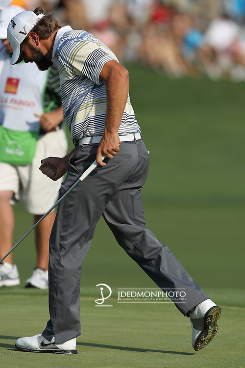 May 8,2011 - Glover reacts with a subdued fist pump after finishing strong at 18.  Lucas Glover wins the tournament in sudden death over Jonathan Byrd at Quail Hollow Country Club,Charlotte,NC.