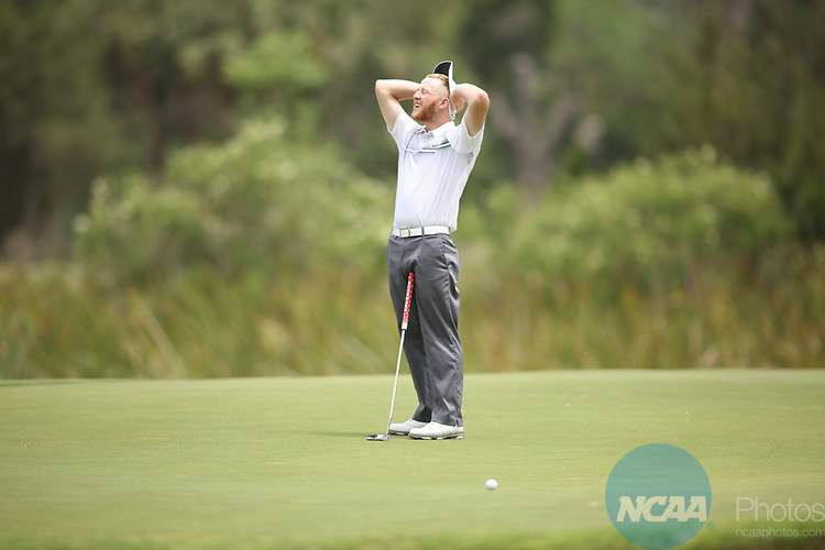 HOWEY IN THE HILLS, FL - MAY 19: Sam Stilwell of Wittenberg University reacts to a missed putt on the 16th green during the Division III Men's Golf Championship held at the Mission Inn Resort and Club on May 19, 2017 in Howey In The Hills, Florida. (Photo by Cy Cyr/NCAA Photos via Getty Images)