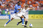 Oct 05 2007:  Scott Sealy (19) of the Wizards battles for the ball with Brian Carroll (r) of D.C. United.  The MLS Kansas City Wizards tied the visiting D.C.United 1-1 at Arrowhead Stadium in Kansas City, Missouri, in a regular season league soccer match.