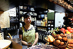 Chizuru Doi stands behind the counter at Enoki, a bar-cum-eatery she has run for some 25 years in Nonbeiyokjocho, or Drunkard's Alley, in trendy Shibuya district, Tokyo. Bottles of Japanese shochu bought by regular customers at Enoki are named and stored on the shelves of the tiny bar-cum-eatery in Nonbeiyokocho, or Drunkard's Alley, in Nonbeiyokocho began life immediately after World War II as group of tea houses. Though the alley is just a short walk from the central Shibuya shopping district, the rents are low due to the area being built over a river. Today 47 eateries, each with barely enough room to swing a cat, serve beer, fine wines and good, inexpensive fare.
