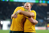 Stephen Moore (R) congratulates Kane Douglas of Australia during Match 26 of the Rugby World Cup 2015 between England and Australia - 03/10/2015 - Twickenham Stadium, London<br /> Mandatory Credit: Rob Munro/Stewart Communications