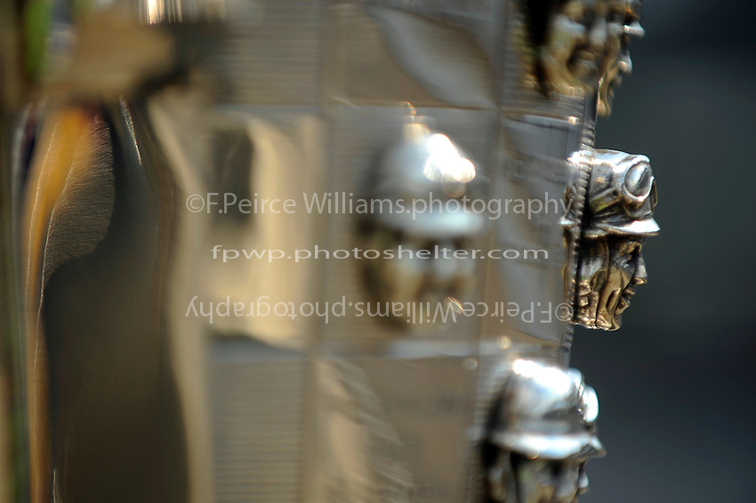 The likeness of 1950 Indianapolis 500 Winner Johnnie Parsons on the Borg-Warner Trophy. (Appears as Johnny Parsons on the trophy)