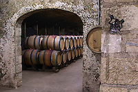 a glass pipette sampler and oak barrels dom rossignol trapet gevrey-chambertin cote de nuits burgundy france