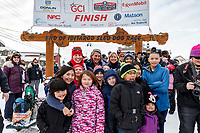 Aliy Zirkle poses with a group of students at the finish line in Nome shortly after finishing the 2019 Iditarod in 4th place on Wednesday March 13<br /> <br /> Photo by Jeff Schultz/  (C) 2019  ALL RIGHTS RESERVED