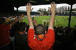 FC United of Manchester 8, Glossop North End 0, 28/10/2006. Gigg Lane, Bury, North West Counties League division one. A fan celebrates a goal as FC United of Manchester defeat Glossop North End (blue shirts) 8-0 in a North West Counties division one match at United's home stadium, Gigg Lane, home to Bury FC. The match was staged on People United Day, an event started in 1999 which brought together fans from across Europe to campaign against racism. FC United were formed in the summer of 2005 by supporters of Manchester United in response to the take over of their club by American millionaire Malcolm Glazer and his family. The club entered the football pyramid at the lowest level with the intention to climbing through the leagues. FCUM won the match 8-0, watched by 3257 spectators. Photo by Colin McPherson.